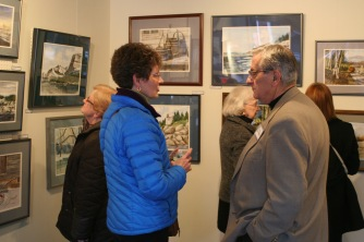 Featured Artist, Rudy Amatangelo visiting with a patron.